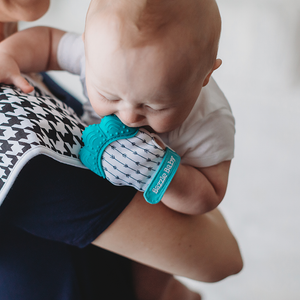 Teething glove in teal and white. BPA free and bacteria resistant silicone teething mitten.