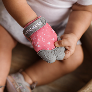 Teething glove in pink and grey. BPA free and bacteria resistant silicone teething mitten.