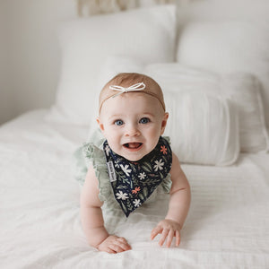 Florals bandana bibs and bandana bib teethers to help prevent drool from getting on clothes and to help provide natural teething pain relief.