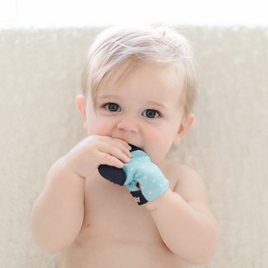 Teething glove in light blue and teal. BPA free and bacteria resistant silicone teething mitten.