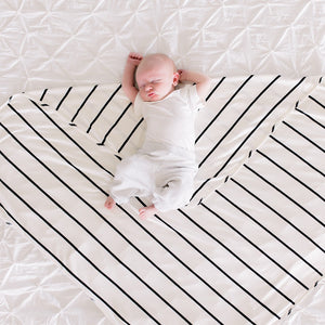 Bazzle Baby Forever Swaddle and Hat Set in classic black and white stripe.