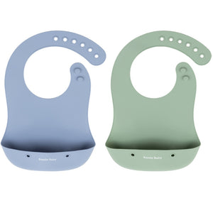 Bazzle Baby Foodie Silicone Bib in periwinkle and sage is waterproof and stain-resistant. Rolls up and buttons closed to store utensils or keep messes contained.