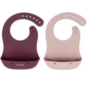 Bazzle Baby Foodie Silicone Bib in cranberry and mauve is waterproof and stain-resistant. Rolls up and buttons closed to store utensils or keep messes contained.