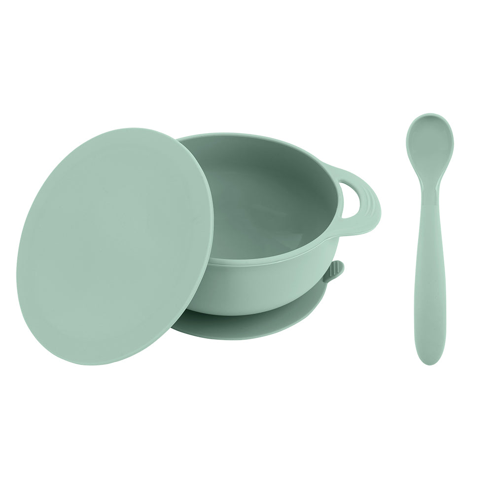 Bazzle Baby Anchor Silicone Bowl and Spoon Set in sage. Suctions to flat surfaces to not fall or slip. Silicone spoon can double as a teething spoon!