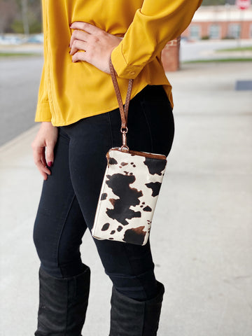 The Riley Crossbody/Wristlet in Cow Print