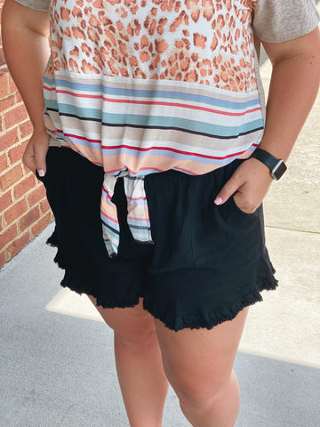 The Kelly Ruffle Hem Shorts in Black