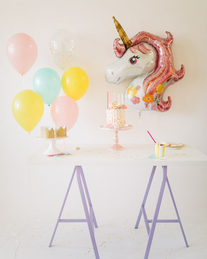unicorn birthday party box and dessert table