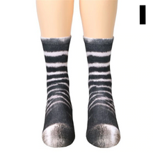 Load image into Gallery viewer, These funny animal paw socks from What on Earth turn your feet into ..