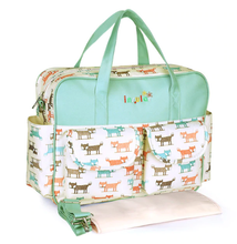 Insular Baby nappy bag green and white with doggy prints