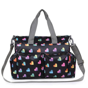 Insular baby nappy bag heart prints