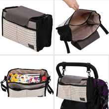 Black top pram organiser in use and view inside the bag