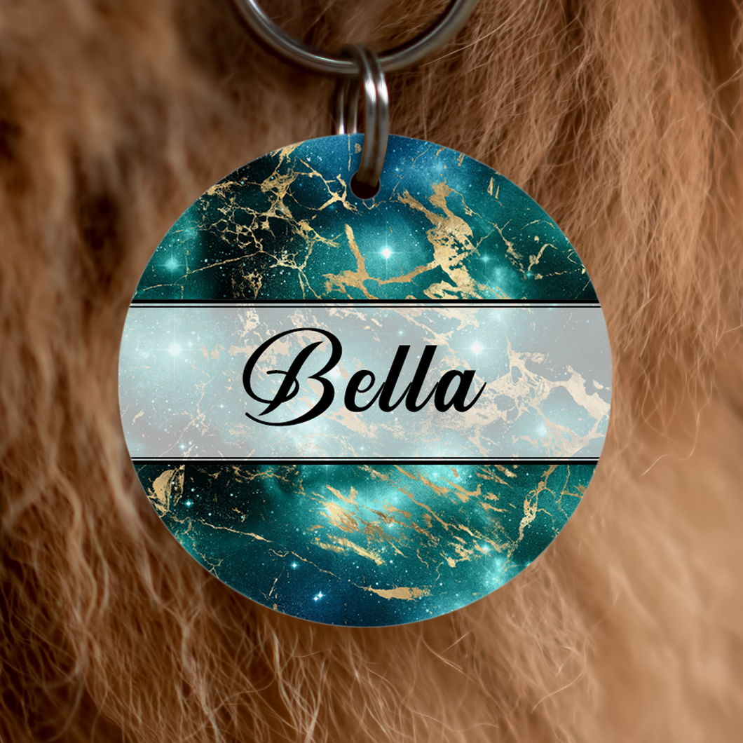 Beautiful-dog-tag-in-galaxy-design-featuring-blues-greens-and-golds-and-featuring-dogs-name-bella-and-personalisable-with-your-dogs-name