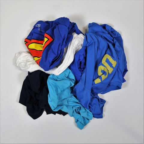 pile of sorority t-shirts for a sorority t-shirt quilt