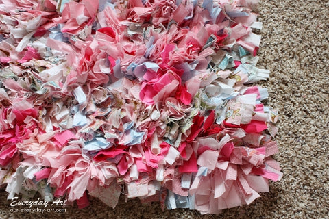 pink and white rag rug made out of t-shirts
