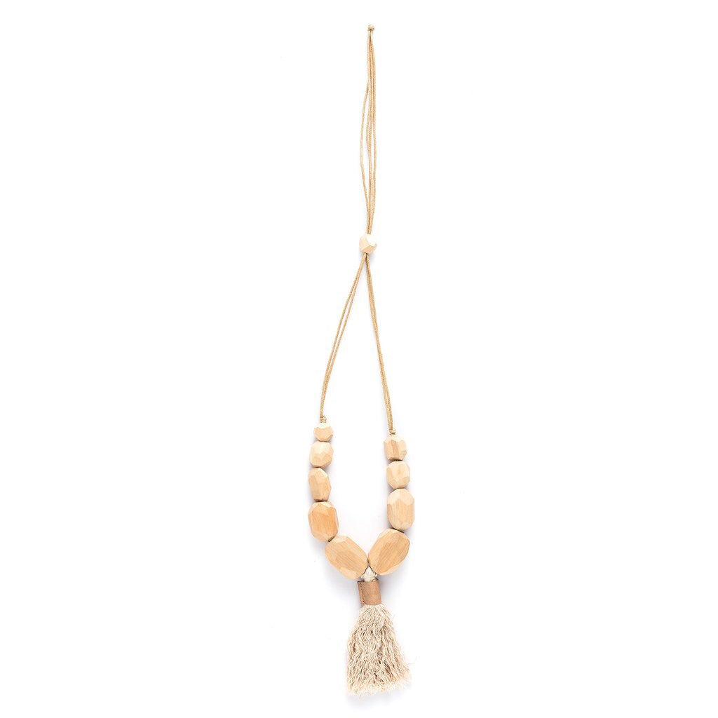 Faceted rocks with tassel necklace