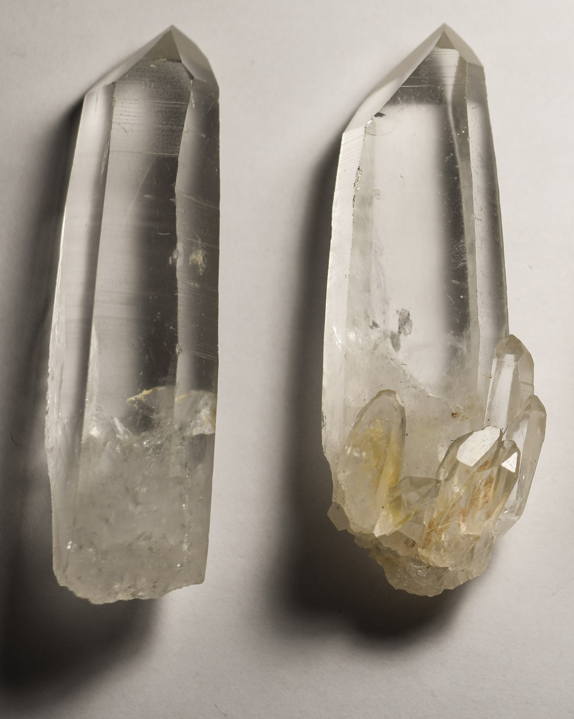 Crystal points on iron stand.