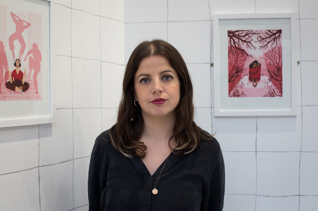 Nina Cosford standing in front of her period-themed artwork for the Out of Order exhibition.