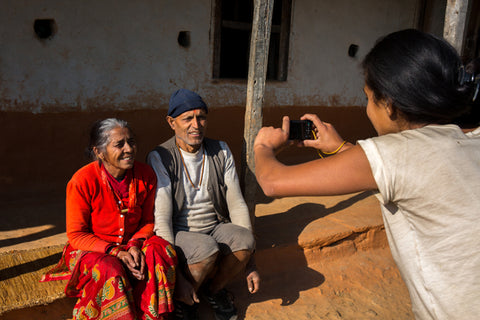 Manisha taking a picture of her relatives for her project