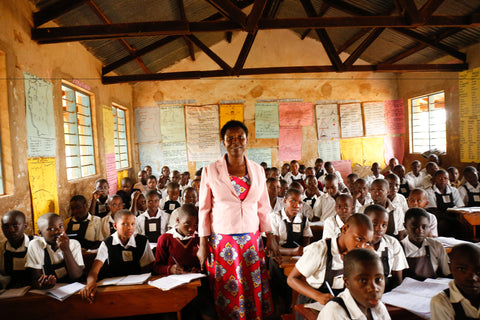 A teacher at Kyenjojo Primary School, teaching her class about periods