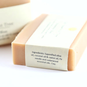 Ingredients listed on soap block packaging: saponified olive oil, coconut oil & castor oil, fir needle and cedarwood essential oils and clay