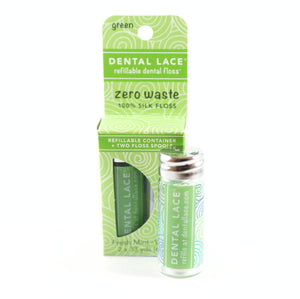 green dental floss canister and green box