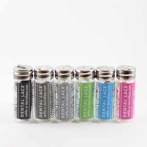 black, grey, pink, blue and green glass vials