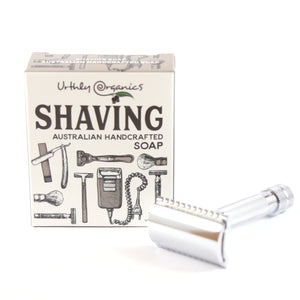 cardboard shaving soap packaging beside a silver safety razor