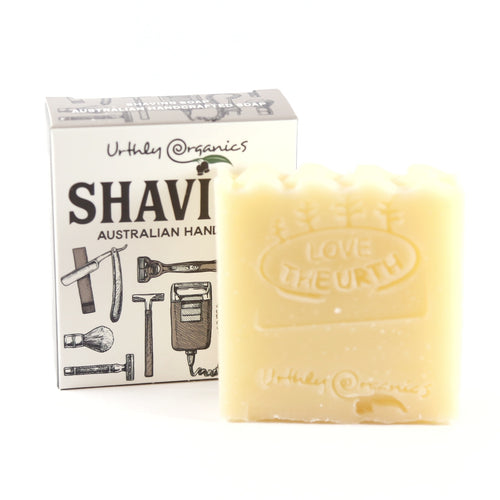 solid block of shaving soap beside its cardboard packaging