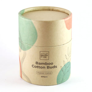 singular cylindrical cardboard tube with lid on. white background. tube labeled 'bamboo cotton buds'