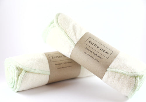 2 separate rolls of reusable cloth wipes. wipes are white with green trim
