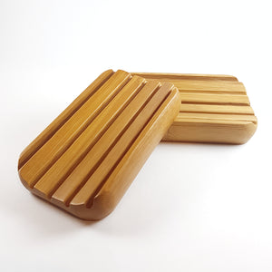 2 wooden soap dishes with deep grooves