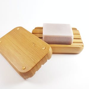 2 wooden soap dishes with a lavender soap on 1