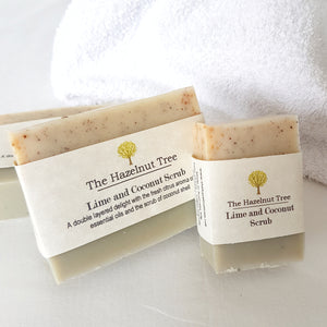 3x soaps with bottom half pale green and top half beige with coconut exfoliant in the texture