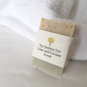 guest soap with bottom half pale green and top half beige with coconut exfoliant in the texture