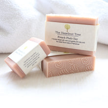 Load image into Gallery viewer, 3 pink soaps lying on white towel