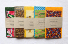 Load image into Gallery viewer, A range of various coloured beeswax wraps