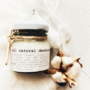 Small glass jar labelled all natural deodorant