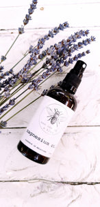 Amber glass spray bottle containing magnesium oil. Lavender in background