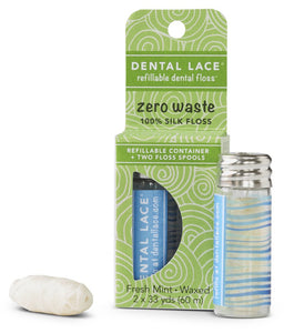 blues waves printed on small glass vial of dental floss