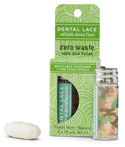 Camouflage print on small glass vial containing dental floss