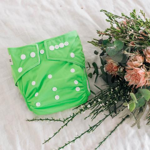 a bright green cloth nappy