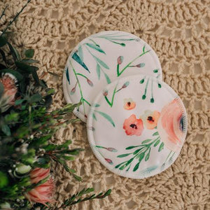 2 round breast pads of floral design