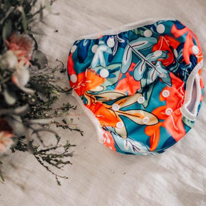 colourful floral print on single swimming nappy