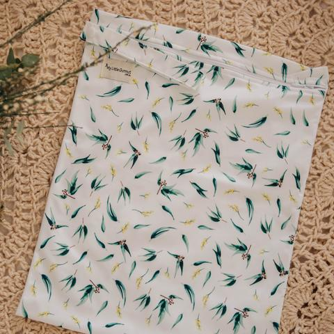 a rectangular bag, white with gumnuts and leaves print