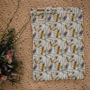 a rectangular bag, white with banksia print