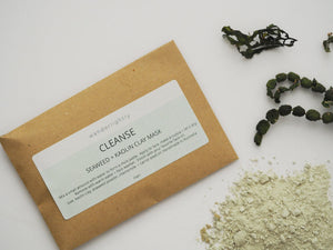 Small card envelope labelled 'cleanse. seaweed and kaolin clay mask'. some dry clay powder and seaweed in the image