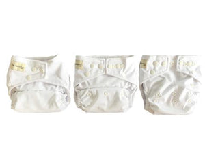 The same white nappy, side by side, 3 in a row, all adjusted differently to show that they fit multiple sizes