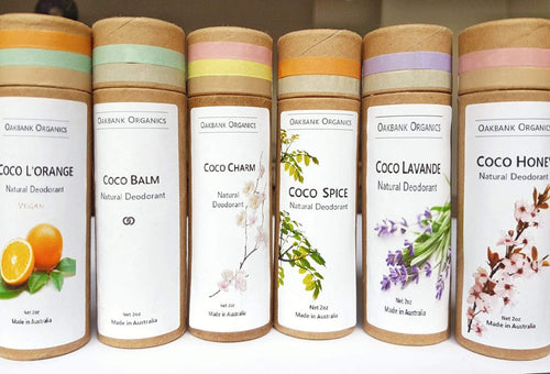 6 cardboard tube deodorants next to each other, each displaying different colour labels