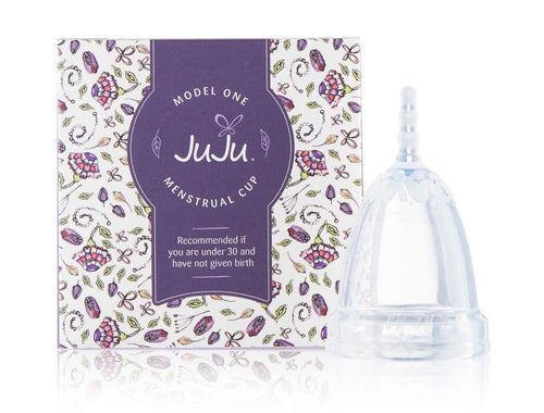 clear menstrual cup beside purple box