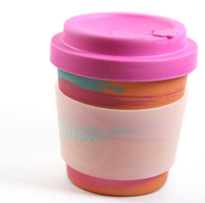 orange coffee cup with pink lid